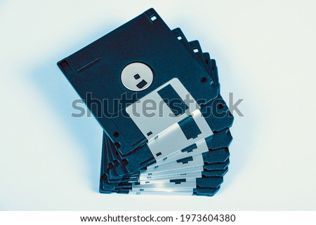 Toned Photo of Floppy Disks Drive Set on the Paper Background closeup