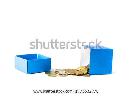 Coins pouring out of the gift box. Concept of the value of the gift. cashback.
