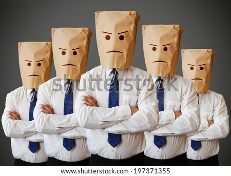 Businessman with a paper bag with angry face on it