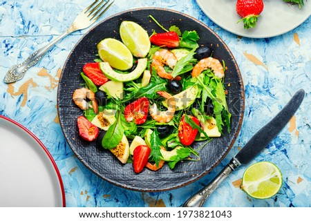 Fresh summer salad with prawn,strawberry,avocado,lime and olive.Summer salad,healthy eating Royalty-Free Stock Photo #1973821043