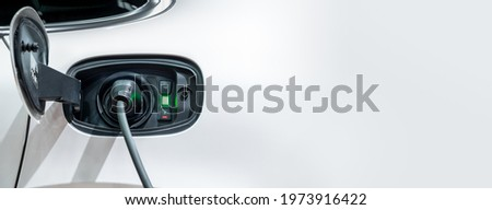 White electric car charging with copy space, Technology electric vehicle concept Royalty-Free Stock Photo #1973916422