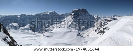 winter panorama picture from the mountain gemsairenstock towards toedi piz russein with the clariden glacier. mountains