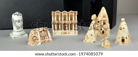Set of Turkish historical monuments, mini statue sculpture figures. Izmir Bergama Ephesus, Cappadocia, Trabzon Sumela monastery historical and touristic gifts and souvenirs. Turkish souvenirs set.  Royalty-Free Stock Photo #1974085079