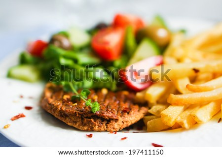 Steak with french fries and salad #197411150