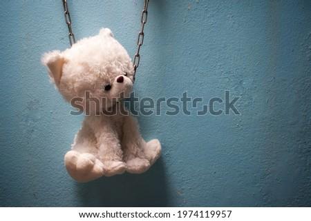 Teddy puppy wall vignette blue background sad mood concept