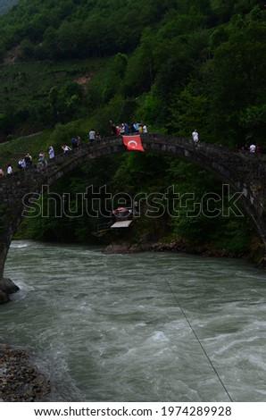 Rize, Turkey: July 2019: The historical Ottoman (Timisvat) Bridge over the Fırtına Creek Valley. Tourists take pictures on the bridge. Camlihemsin, Ardesen, Rize, Turkey.