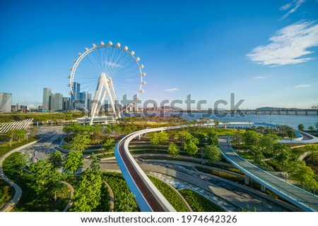 Ferris wheel in downtown of shenzhen china city Royalty-Free Stock Photo #1974642326