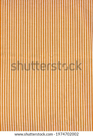 Orange striped tablecloth background texture. Fabric wallpaper