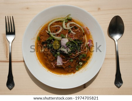 """Flatlay picture of """"Laksa Johor"""" serve during Eid Mubarak. Spaghetti in place of rice noodles, with mince fish curry and coconut milk added at certain vendors."""