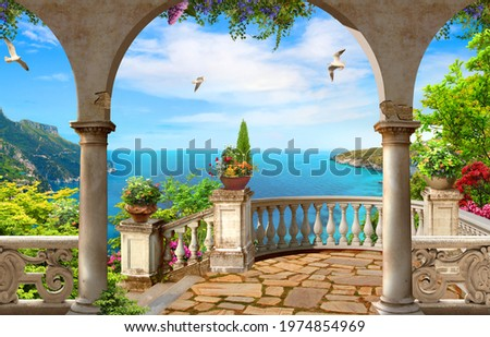 View from the balcony to the blue sunny sea with an arch Royalty-Free Stock Photo #1974854969