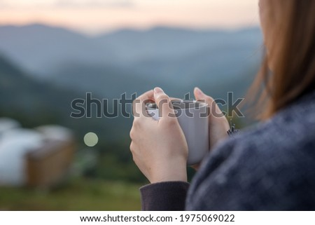 solo woman drink coffee with relax and wellbeing feel with mountain background Royalty-Free Stock Photo #1975069022