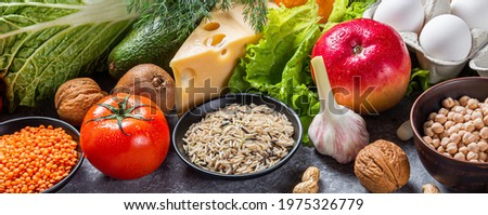 Conceptual multicolored image of a diet balance food with vegetables and fruits. Nutrition and diet picture with copyspace