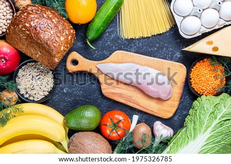 Conceptual image of a healthy food balance with vegetables fruits and meat nutrition and diet picture with copyspace