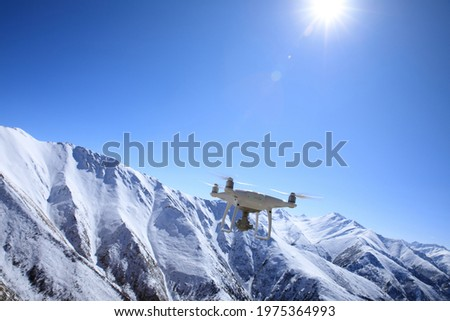 Flying drone taking picture of snow mountains in Tibet,China