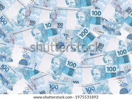 several banknotes of one hundred reais from brazil, texture of brazilian money, notes of reais background Royalty-Free Stock Photo #1975531892