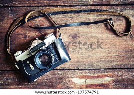 Old retro camera on vintage wooden boards abstract background Royalty-Free Stock Photo #197574791