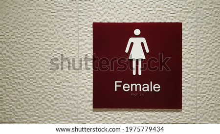 Female public toilet sign with braille and tactile sign and universal design concept