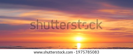 Sunset sky clouds background. Beautiful landscape with clouds and orange sun on sky. High quality photo Royalty-Free Stock Photo #1975785083