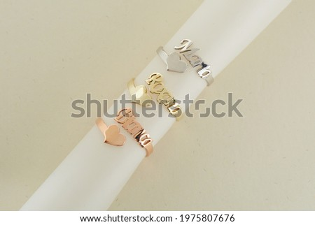 Gold jewelry. Gold Name Rings Background