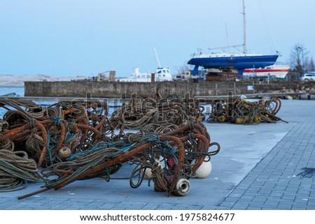 old metald ock ties on the waterway Royalty-Free Stock Photo #1975824677