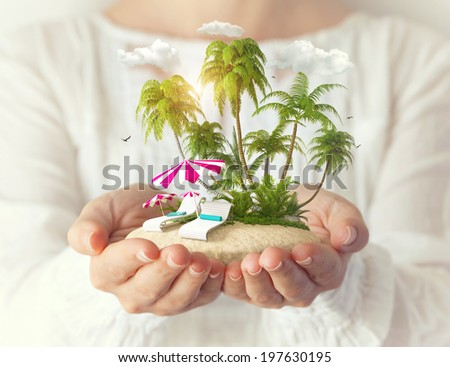 Small fantastic island with sunbeds and palms in women's hands. Tropical vacation