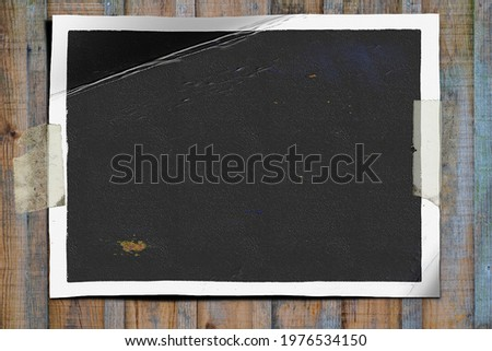 mock up photo on old wooden wall with adhesive tape