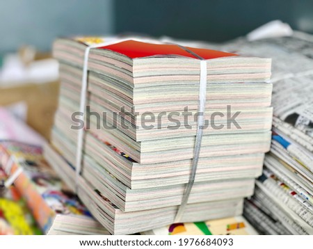 Bundled comic magazines and old newspapers Royalty-Free Stock Photo #1976684093