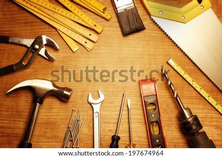 Assorted work tools on wood #197674964