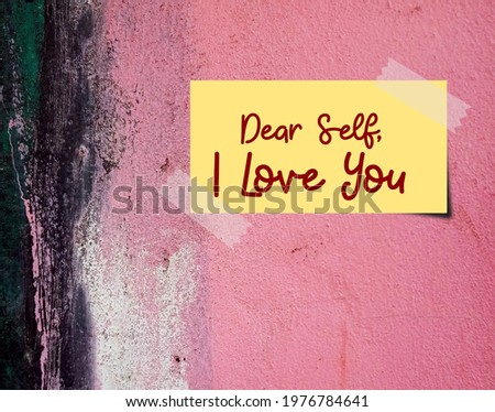 Stick note on pink grunge vintage wall with text written DEAR SELF I LOVE YOU, means build up self esteem, fully respect and accept imperfection just the way it is than seeking approval from others