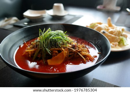 Chinese-style dish of vegetables, pork, seafood, etc. stir-fried in oil and boiled in stock.
