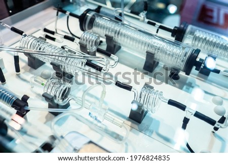 Medical laboratory equipment. Medical device with glass coils. Equipment for medical experiments. Device for analysis of chemical substances. Lab device close-up. Apparatus for laboratory research Royalty-Free Stock Photo #1976824835