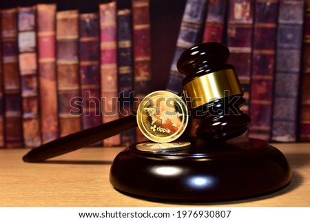 Judge hammer and XRP crypto coin. Justice courtroom. Ripple demands Bitcoin and Ethereum docs from SEC amid legal fight. Delist сryptocurrency trading. Exchanges and traders. law to ban blockchain Royalty-Free Stock Photo #1976930807