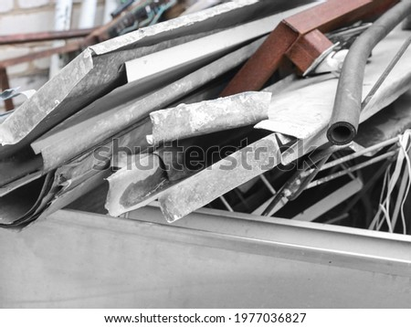 Waster metallic container bin with full with rubbish on factory in workshop. Metal scrap. Recycling Royalty-Free Stock Photo #1977036827