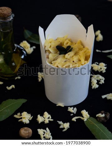 a picture of a pasta plate prepared to be taken away
