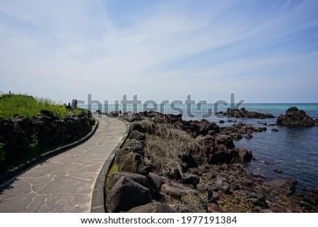 a beautiful seaside landscape with a walkway, scenery around handam walkway Royalty-Free Stock Photo #1977191384