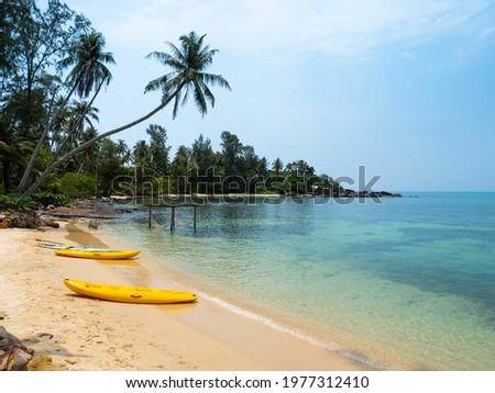 Yellow Kayak boat on tropical island beach white sand under bright sun in summer season. Koh Kood - Thailand