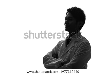 Silhouette of asian people wearing white robe. Royalty-Free Stock Photo #1977312440