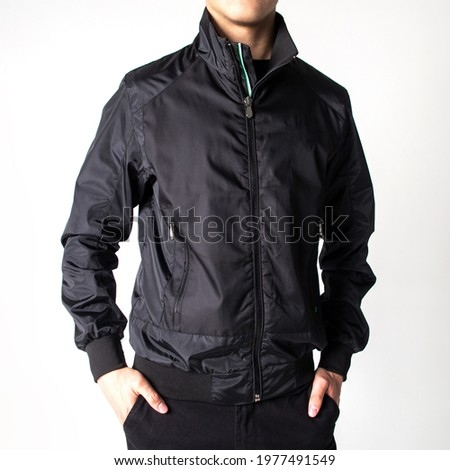guy in a black spring-autumn jacket on a white background.