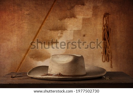 Still life hat in a room over a wooden table