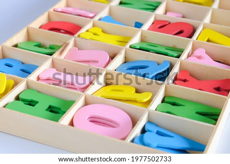 Alphabet Letters  in different colors for decoration of kids in wood box.