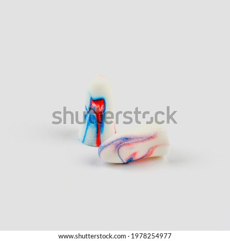 colorful earplugs on a white background