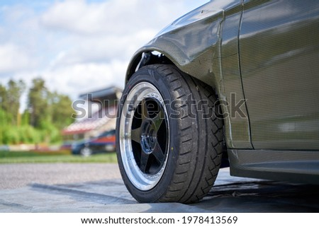 Rear side view front wheel of black car Royalty-Free Stock Photo #1978413569
