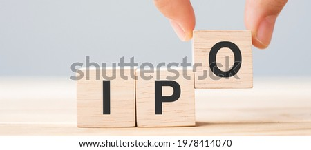 IPO (Initial Public Offering) word with wooden cube block, shares of a private corporation to the public in a new stock issuance. Stock, Fund, Investors and Investment concept