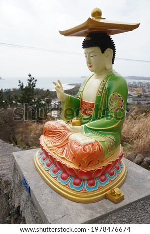 This is a picture of a Buddha statue in a temple in Jeju Island, Korea.