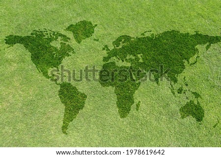 World map on green grass lawn background for global eco-friendly environment, ecological and environmental saving, earth day, and go green backdrop concept  Royalty-Free Stock Photo #1978619642