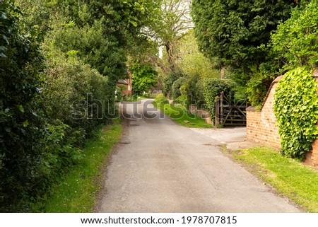 Quiet rural village lane scene Royalty-Free Stock Photo #1978707815