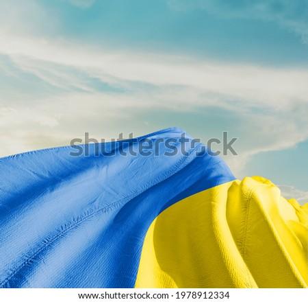 Ukraine waving flag in the sky. Royalty-Free Stock Photo #1978912334