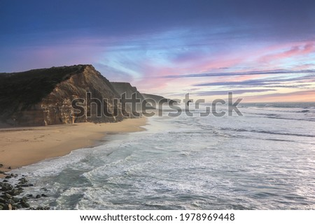 Aerial view of waves on a beautiful sandy ocean beach and cliff at the sunset. Panorama atlantic coastline. Royalty-Free Stock Photo #1978969448