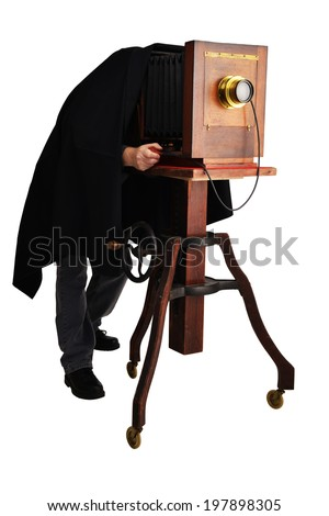 a man using vintage wood 8x10 camera on white with clipping path