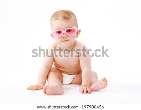 Baby in pink glasses #197900456